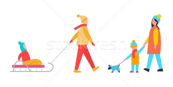 Zajęcia rodzinne zimą mamusia syn spaceru psa Zdjęcia stock © robuart