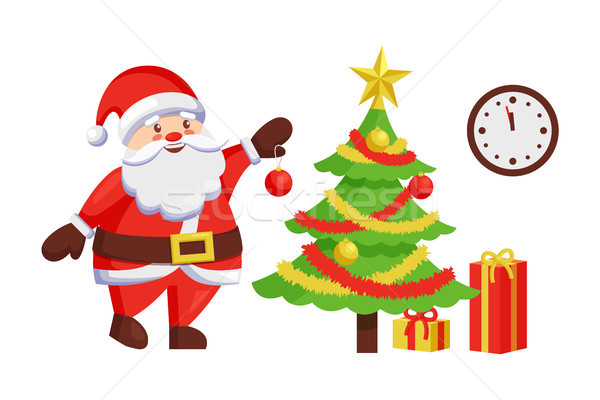 Santa Claus Decorate New Year Tree by Hanging Ball Stock photo © robuart