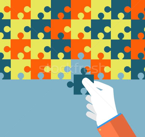 Businessman assembling jigsaw puzzle Stock photo © robuart