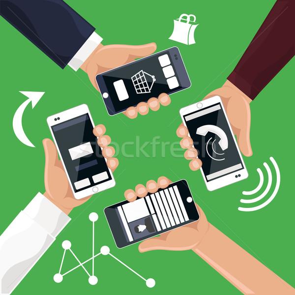 Hands holding smartphones telephones that Stock photo © robuart