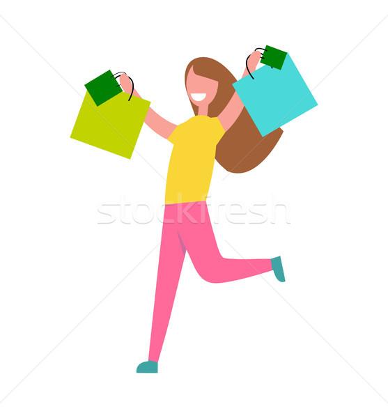 Kadın alışveriş mutlu gülümseyen kadın sarı kazak Stok fotoğraf © robuart