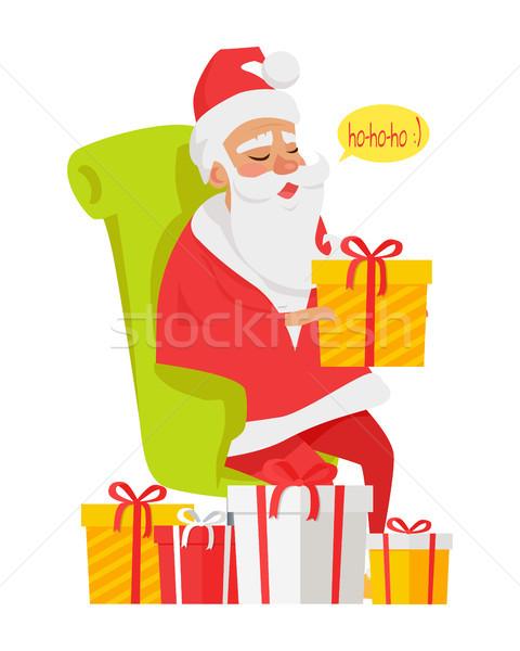 Sitting Santa Claus Among Big Colourful Presents Stock photo © robuart