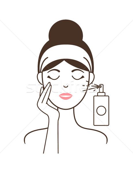 Girl in Headband Aplies Micellar Water from Spray Stock photo © robuart