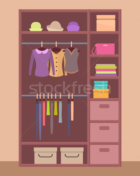 Wooden Wardrobe with Bright Clothes and Warm Hats Stock photo © robuart