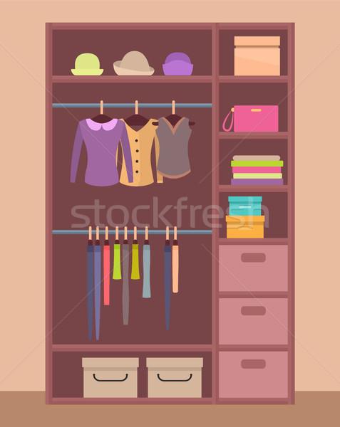 Fából készült ruhásszekrény fényes ruházat meleg sapkák Stock fotó © robuart
