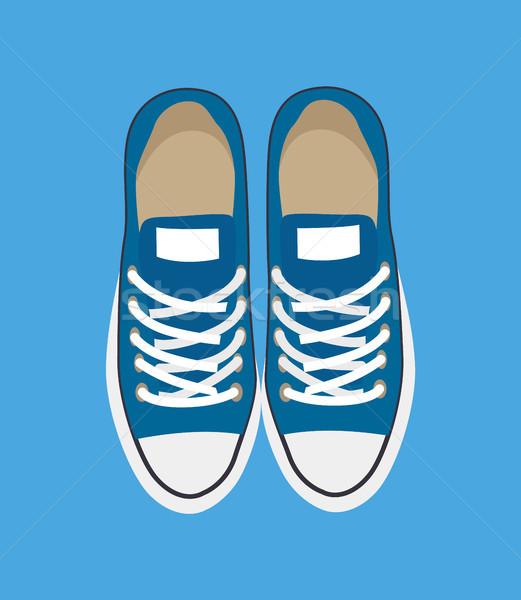 Pár lezser sportcipők izolált kék háttér Stock fotó © robuart