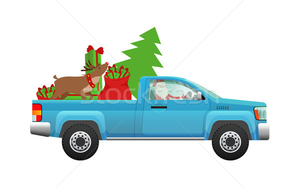 Santa Claus hurry on party. Santa driving pickup loaded with Chr Stock photo © robuart