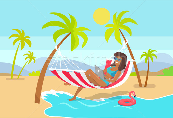 Woman Works as Freelancer in Hammock with Laptop Stock photo © robuart
