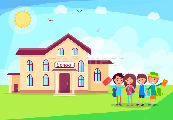 Happy Children Holding Hands in Front of School Stock photo © robuart