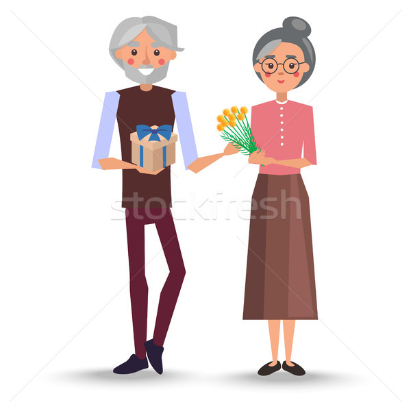 Grandfather Presents Bouquet of Mimosa to Grandma Stock photo © robuart