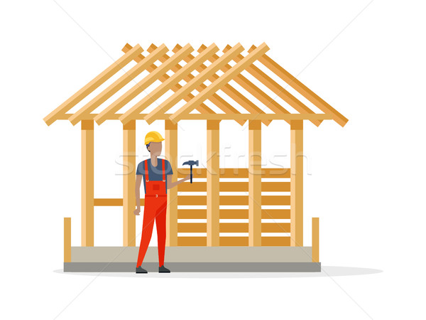 Builder in Helmet and Robe near Constructing House Stock photo © robuart