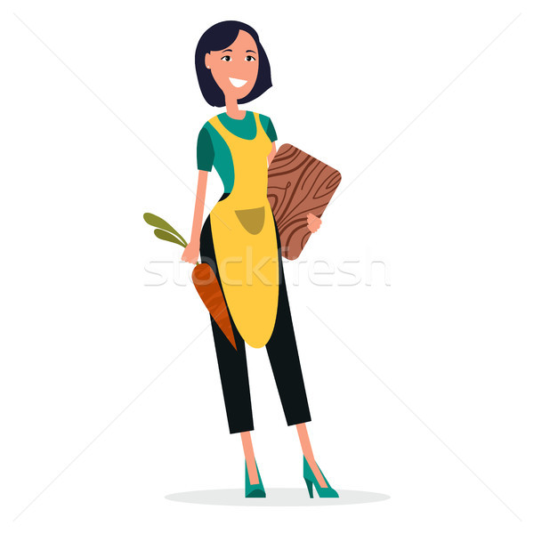 Woman Cooker in Yellow Apron with Cutting Board Stock photo © robuart