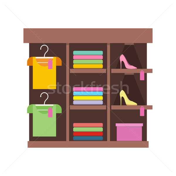 Shelves with Clothes in Shop. Stock photo © robuart