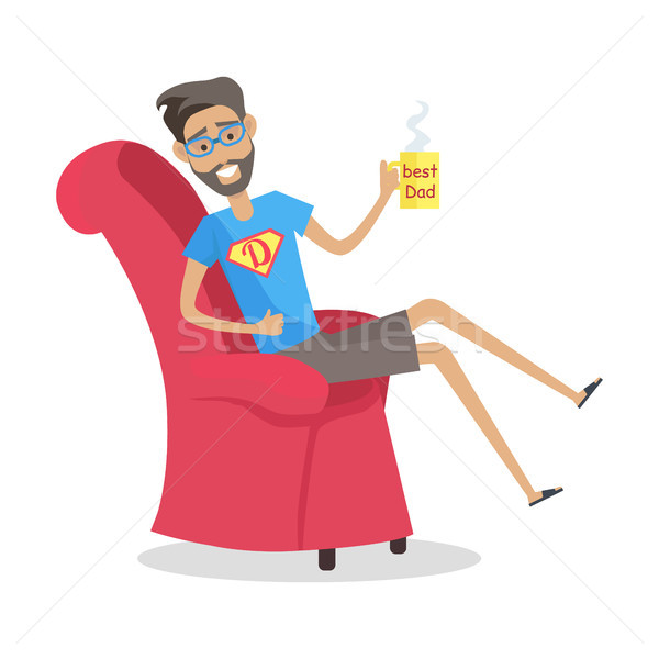 Father Sitting in Arm Chair with Cup of Coffee. Stock photo © robuart