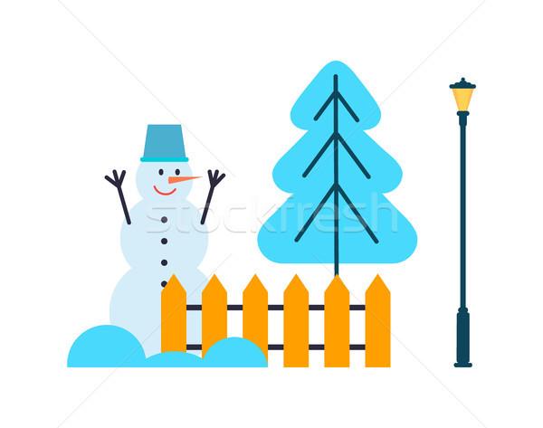 Sneeuwpop handen omhoog kerstboom hek lantaarn emmer Stockfoto © robuart