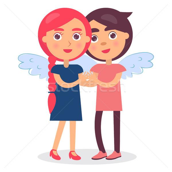 Fiatal szerelmespár tart kezek mosolyog egyéb Stock fotó © robuart