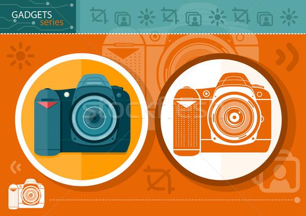 Digital camera in frame on orange background Stock photo © robuart