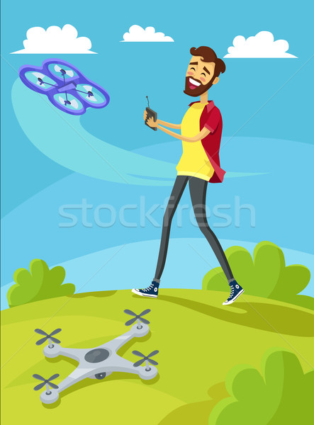 Man Controls the Drone on Lawn Stock photo © robuart