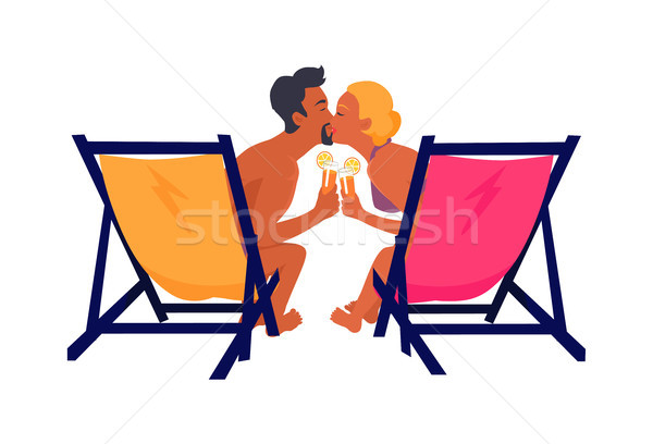 Couple Sits on Recliners with Cocktails and Kisses Stock photo © robuart