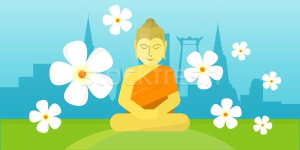 Thai god Buddha sit on meadow over city landscape. Stock photo © robuart