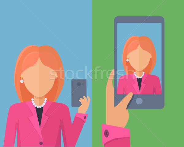 Selfy on Smartphone. Young Woman Taking Self Portrait Stock photo © robuart