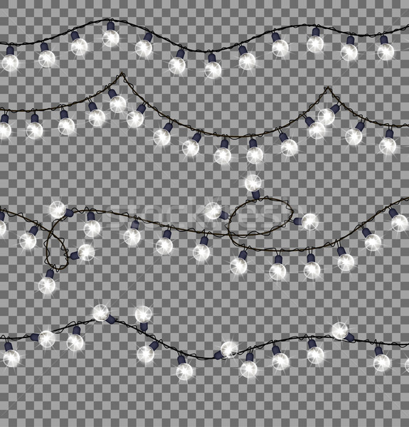 Garlands with Round Bulbs on Dark Background. Stock photo © robuart