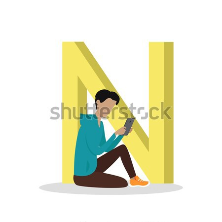 Stock photo: B Letter and Boy Listens to Music on Mobile Phone
