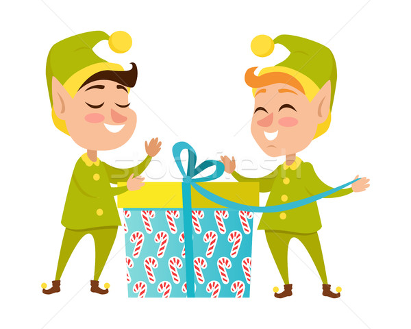 Two Happy Elves with Present on White Background Stock photo © robuart