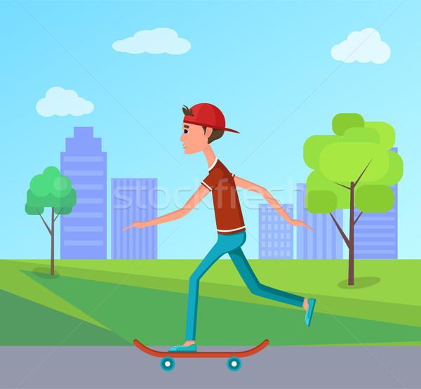 Side View Skateboarder Riding City Park Skateboard Stock photo © robuart