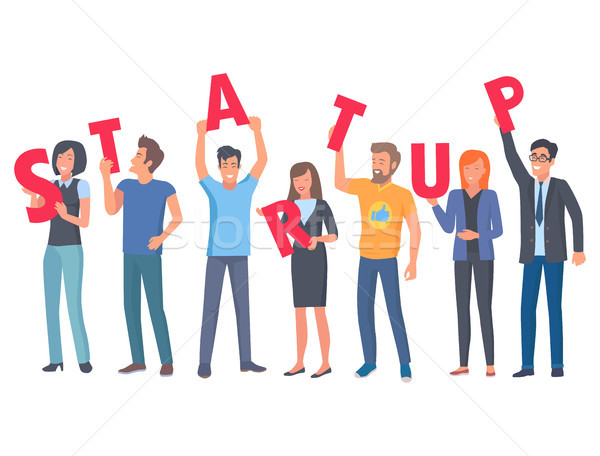 Young People Holding Capital Letters of Startup Stock photo © robuart