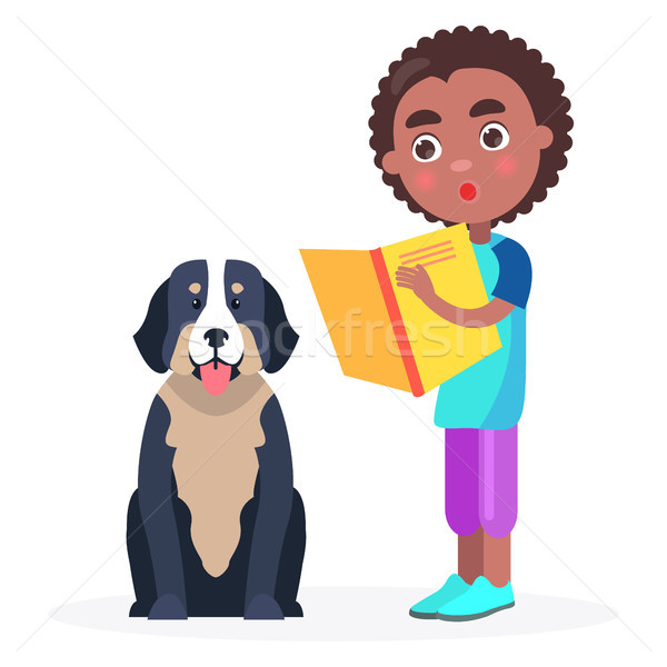 Surprised Kid Stands with Book and Pedigree Dog Stock photo © robuart