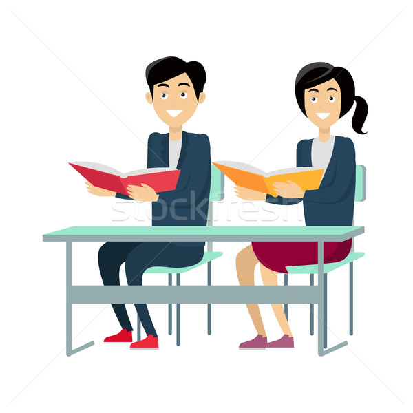 Pupils Sitting at a School Desk Stock photo © robuart