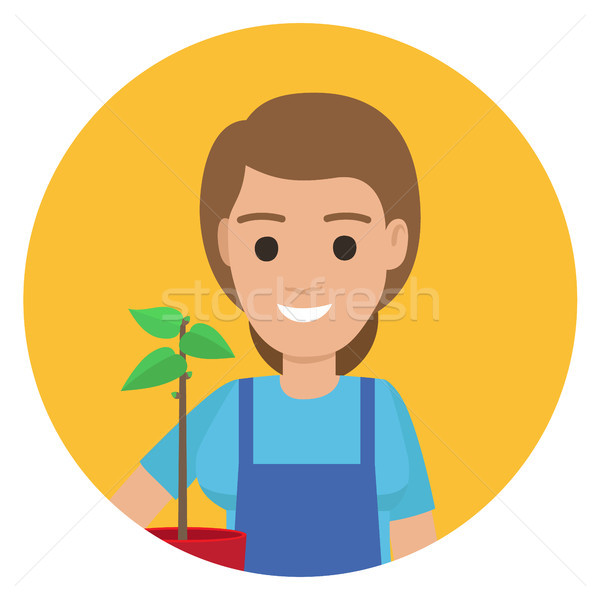 Happy Gardener with Plant in Pot ain Stylish Apron Stock photo © robuart