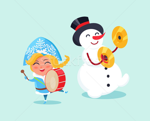 Snow Maiden Play on Drums and Snowman on Cymbals Stock photo © robuart
