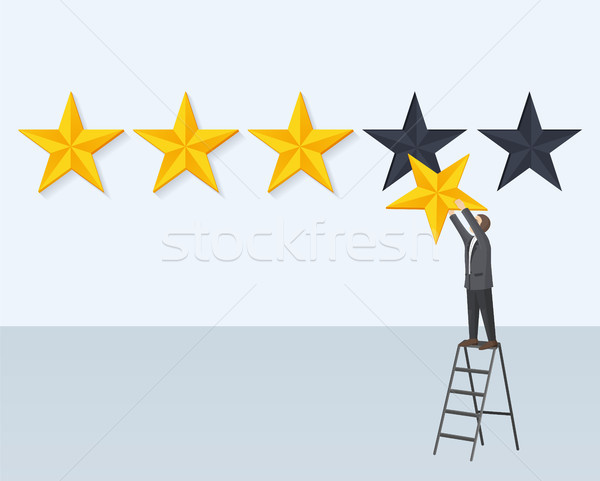 Man Hangs Rating Golden Star Stands on Step-Ladder Stock photo © robuart