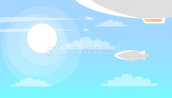 Airships Flying in Sky with Clouds and Shining Sun Stock photo © robuart