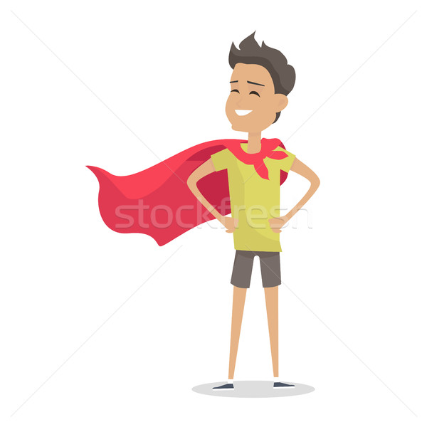 Stock photo: Young Boy in Superman Pose Wearing a Red Cloak.