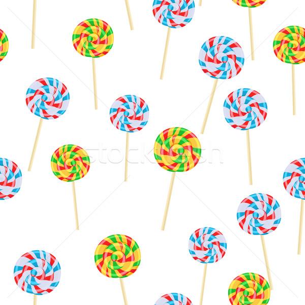 Caramel Striped Candies on Sticks Seamless Pattern Stock photo © robuart