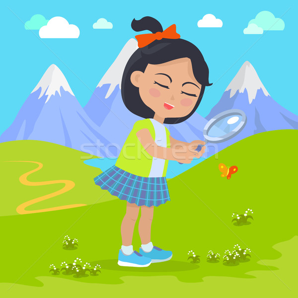 Girl Holds Magnifying Glass in Hands at Mountains Stock photo © robuart