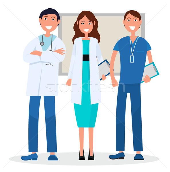 Tres médicos bordo aislado blanco hombres Foto stock © robuart