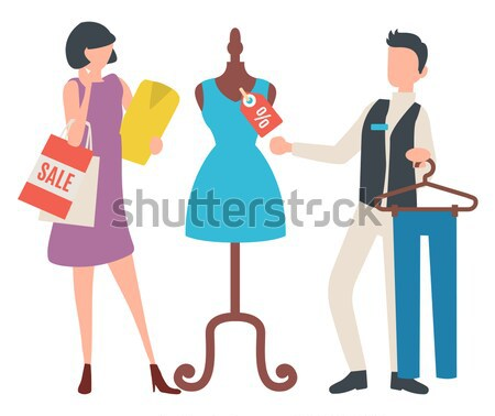 Woman Choosing New Summer Vogue Suit with Trousers Stock photo © robuart
