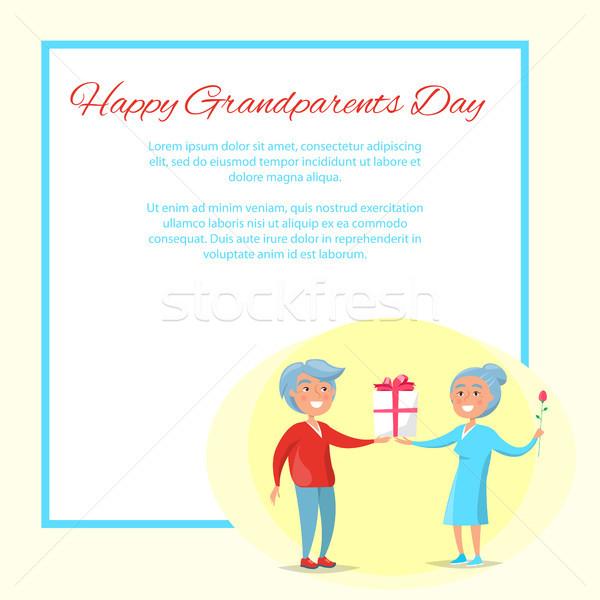 счастливым дедушка и бабушка день давать настоящее Сток-фото © robuart