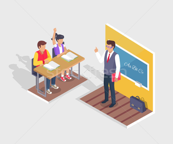 Two Students Boy and Girl Sit at Desk, Teacher Stand Stock photo © robuart