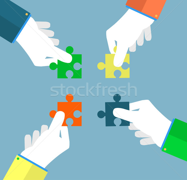 Businessman assembling jigsaw puzzle Stock photo © robuart