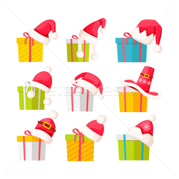 Set of Gift Boxes with Santa Claus Caps on White Stock photo © robuart