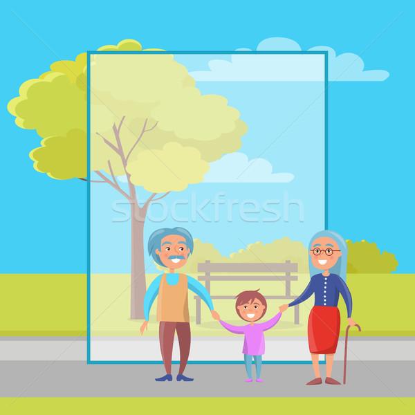 Heureux grands-parents jour couple de personnes âgées petit-fils marche Photo stock © robuart