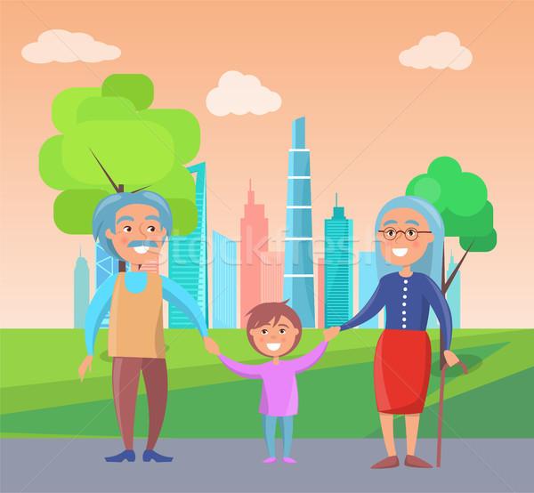 дедушка и бабушка ходьбы внук Небоскребы зеленый деревья Сток-фото © robuart