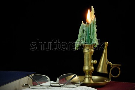 Reading by candle light Stock photo © rogerashford
