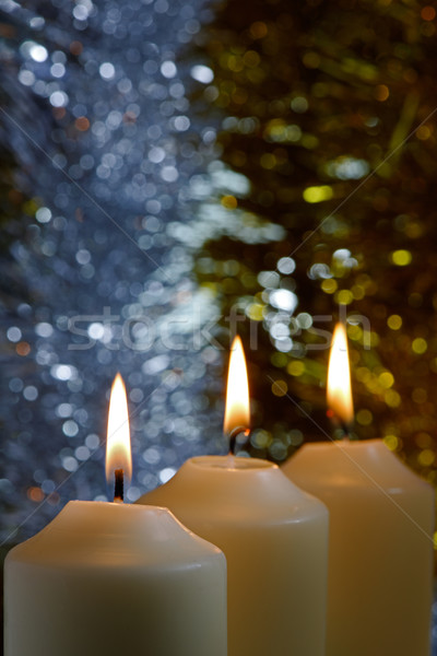 Candles with a Sparkling Tinsel Background Stock photo © rogerashford