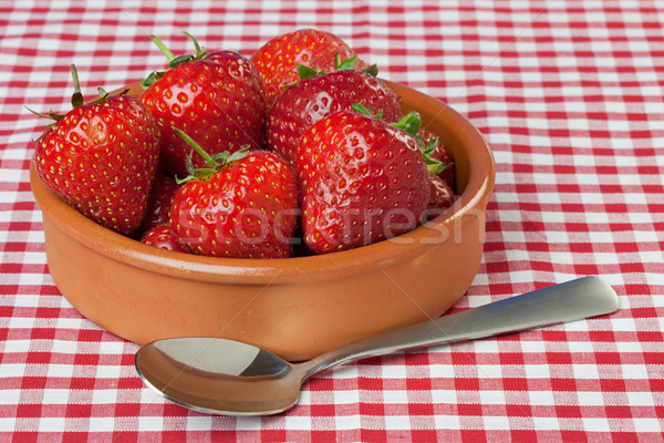 Dish of Strawberries on Red Gingham Tablecloth Stock photo © rogerashford